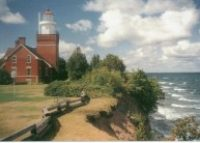 High atop a cliff jutting into the clear, deep waters of Lake Superior, the Big Bay Point Lighthouse beckons adults in search of a secluded retreat from modern life. This unique bed-and-breakfast inn is one of the few surviving resident lighthouses in the country and is listed on the National Register of Historic Places. Stay the night at a working lighthouse on Lake Superior – Big Bay Point Lighthouse Bed and Breakfast Tour the Valley Camp Ship museum in Sault Saint Marie.